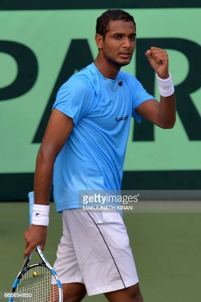 Indian player Ramkumar Ramanathan gestures after scoring a point during a singles match against Uzbekistan's Temur Ismailov at the Davis Cup Asia...
