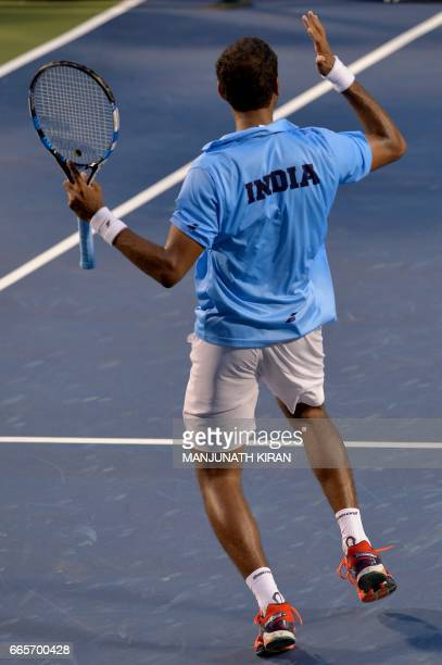 Indian player Ramkumar Ramanathan gestures after scoring a point during his singles match against Uzbekistan's Temur Ismailov at the Davis Cup Asia...