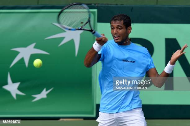 Indian player Ramkumar Ramanathan plays a shot during a singles match against Uzbekistan's Temur Ismailov at the Davis Cup Asia Oceania group one tie...