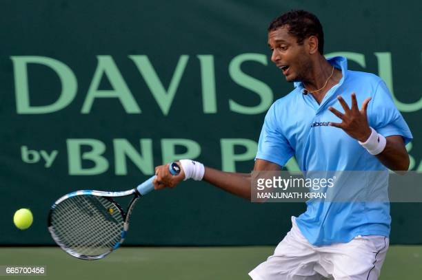 Indian player Ramkumar Ramanathan plays a shot during his singles match against Uzbekistan's Temur Ismailov at the Davis Cup Asia Oceania group one...
