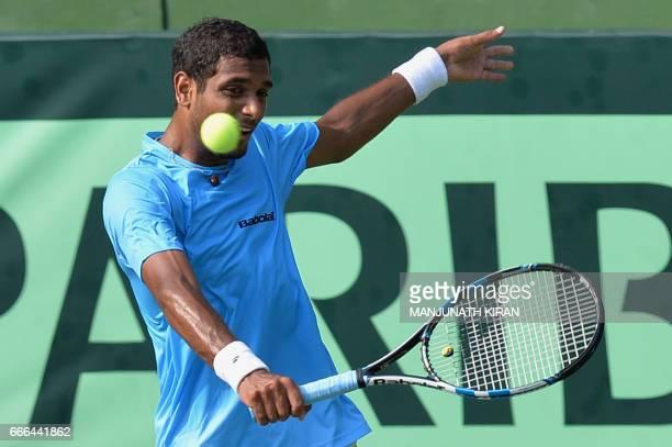Indian player Ramkumar Ramanathan plays a shot during his singles match against Uzbekistan's Sanjar Fayziev at the Davis Cup Asia Oceania group one...