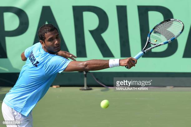 Indian player Ramkumar Ramanathan plays a shot during his singles match against Uzbekistan's Sanjar Fayziev at the Davis Cup Asia Oceania group one...