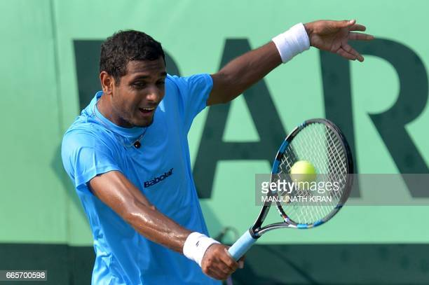 Indian player Ramkumar Ramanathan plays a shot during singles match against Uzbekistan's Temur Ismailov at the Davis Cup Asia Oceania group one tie...