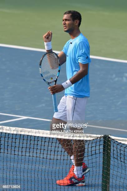 Indian player Ramkumar Ramanathan reacts after scoring a point during his singles match against Uzbekistan's Temur Ismailov at the Davis Cup Asia...