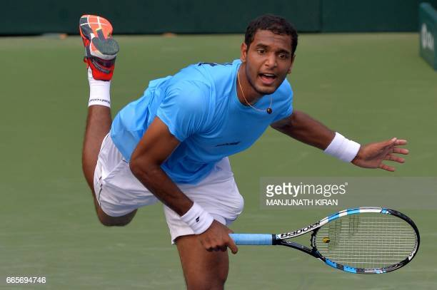 Indian player Ramkumar Ramanathan serves during a singles match against Uzbekistan's Temur Ismailov at the Davis Cup Asia Oceania group one tie match...