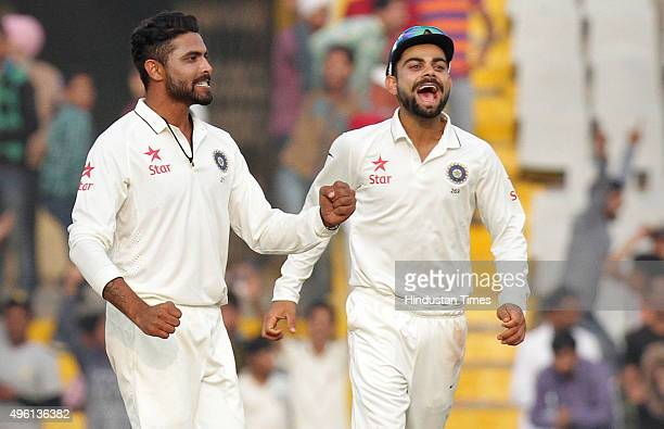 Indian player Ravindra Jadeja celebrating with Captain Virat Kohli after dismissal of South African player Imran Tahir during the third day of first...