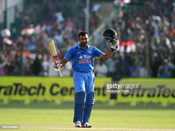 Indian player Rohit Sharma completes his century against South Africa during the first One Day International match between India vs South Africa at...