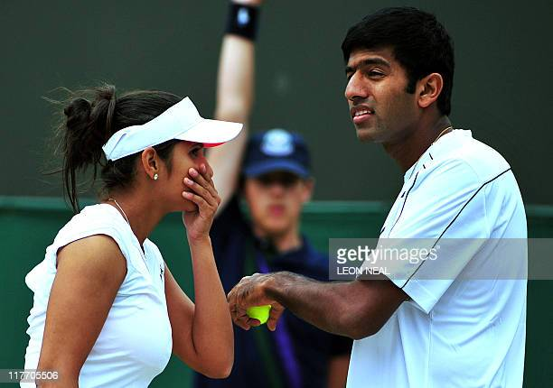 Indian player Sania Mirza and Indian player Rohan Bopanna talk as they play against Bristish player Jamie Murray and Australian player Jarmila...