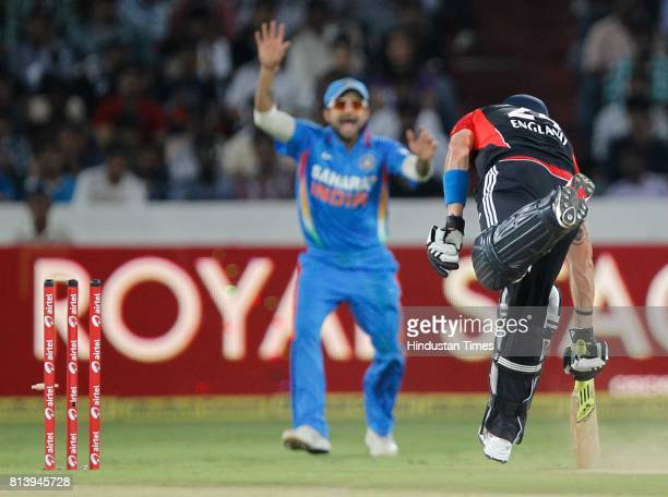 Indian player Virat Kohli celebrates the runout of England player Kevin Pietersen during the 1st One Day International between England and India at...