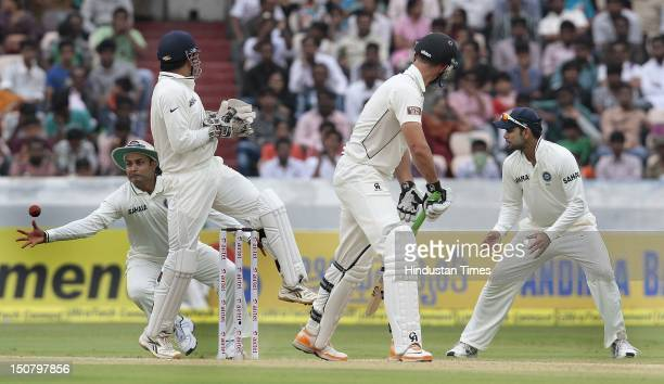 Indian player Virender Sehwag takes an easy catch off the bowling of Ravichandran Ashwin during the fourth day of the first Test match between India...