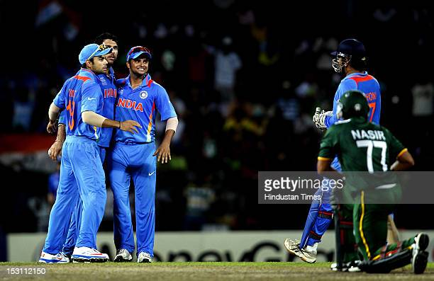 Indian player Yuvraj Singh Captain MS Dhoni Virat Kohli and Suresh Raina celebrates the dismissal of Pakistani player Nasir Jamshed during the ICC...