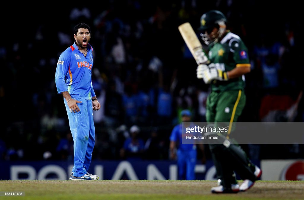 Indian player <a gi-track='captionPersonalityLinkClicked' href=/galleries/search?phrase=Yuvraj+Singh&family=editorial&specificpeople=220785 ng-click='$event.stopPropagation()'>Yuvraj Singh</a> celebrates the dismissal of Pakistani player <a gi-track='captionPersonalityLinkClicked' href=/galleries/search?phrase=Kamran+Akmal&family=editorial&specificpeople=221679 ng-click='$event.stopPropagation()'>Kamran Akmal</a> during the ICC T20 World Cup, Super Eight group 2 cricket match between India and Pakistan at R. Premadasa Stadium on September 30, 2012 in Colombo, Sri Lanka.