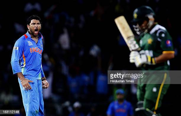Indian player Yuvraj Singh celebrates the dismissal of Pakistani player Kamran Akmal during the ICC T20 World Cup Super Eight group 2 cricket match...