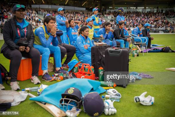 Indian players and managment look on as the team collapses during The ICC Women's World Cup 2017 Final between England and India at Lord's Cricket...