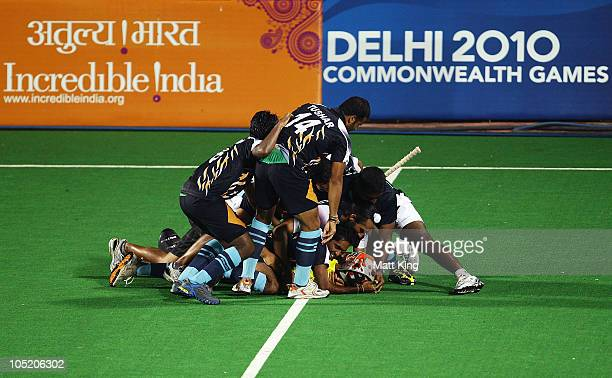 Indian players celebrate after India won a penalty shoot outduring the Men Semifinals Match between England and India at Major Dhyan Chand National...