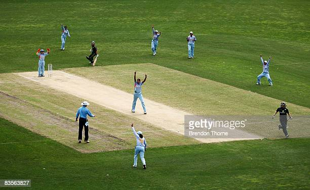 Indian players celebrate after running out Karen Rolton of Australia during the third women's one day international match between the Australian...