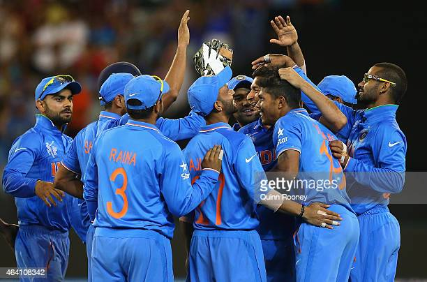Indian players celebrate the run out David Miller of South Africa during the 2015 ICC Cricket World Cup match between South Africa and India at...