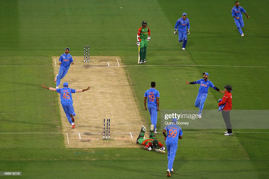 Indian players celebrate the run out of Imrul Kayes of Bangladesh during the 2015 ICC Cricket World Cup Quater Final match between India and...
