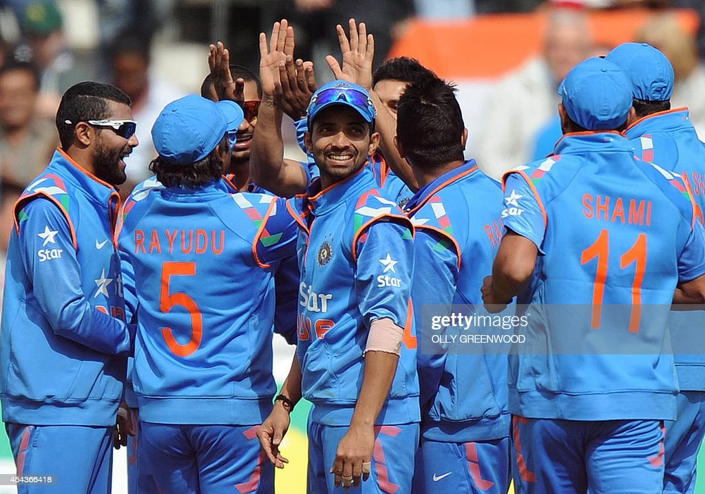 Indian players celebrate the wicket of England's Ian Bell who was run out by a a direct hit from the field by India's Mohit Sharma during the third one-day international cricket match between England and India at Trent Bridge in Nottingham, central England on August 30, 2014.
