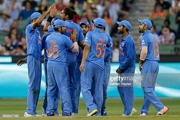 Indian players celebrate the wicket of Shaun Marsh of Australia during game three of the One Day International Series between Australia and India at...