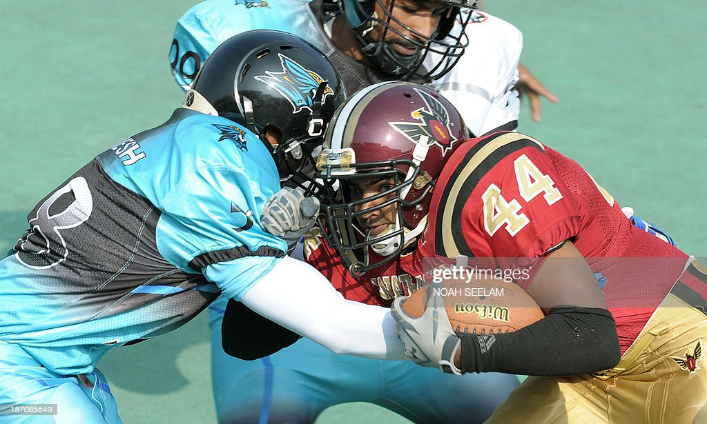 Indian players from the Hyderabad Skykings and the Bangalore Warhawks particiapte in an Elite Football League of India American Football exhibition...