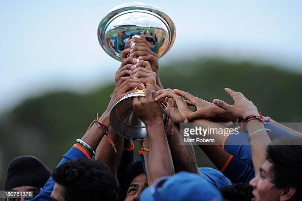 Indian players hold the trophy aloft after the 2012 ICC U19 Cricket World Cup Final between Australia and India at Tony Ireland Stadium on August 26...
