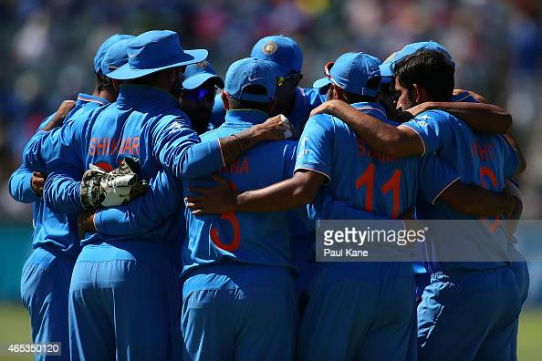 Indian players huddle before taking to the field during the 2015 ICC Cricket World Cup match between India and the West Indies at WACA on March 6...
