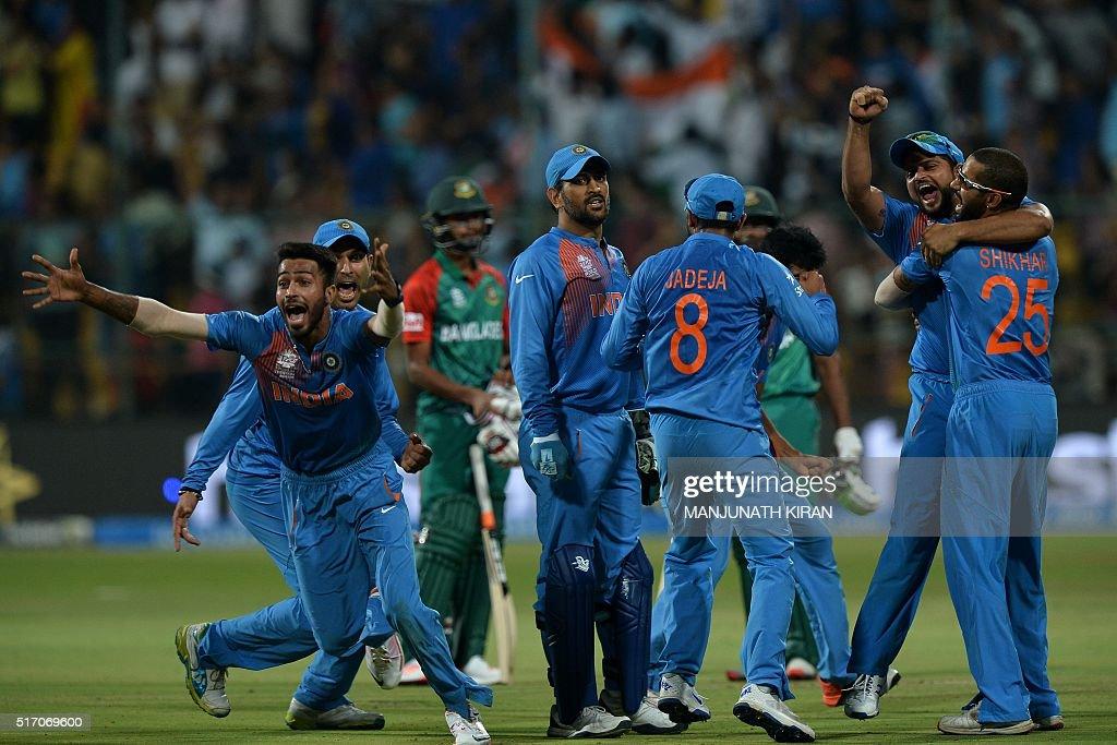 Indian players including Hardik Pandyacaptain Mahendra Singh DhoniSuresh Rainaand Shikhar Dhawancelebrate the wicket that led to the victory of India...