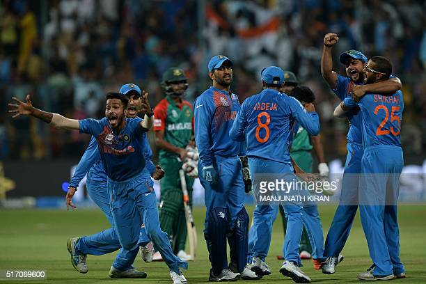 Indian players including Hardik Pandyacaptain Mahendra Singh DhoniSuresh Rainaand Shikhar Dhawancelebrate the wicket that led to the victory of India...