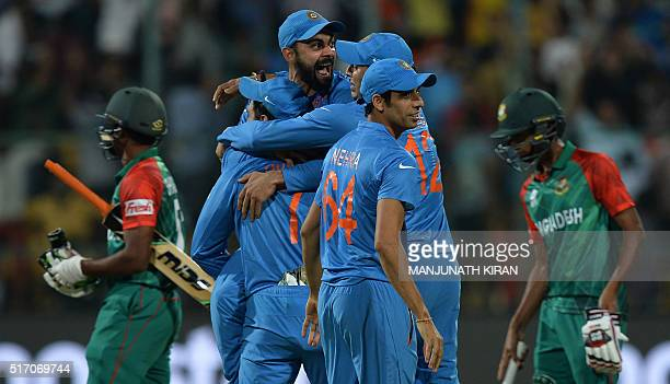 Indian players including Virat Kohliand Ashish Nehracelebrate the wicket that led to the victory of India on the last ball by 2 runs during the World...