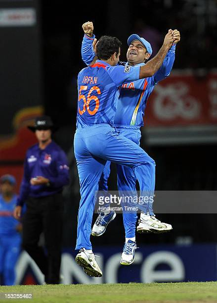 Indian players Irfan Pathan and Virender Sehwag celebrate after the dismissal of South African player Jacques Kallis during the ICC T20 World Cup...