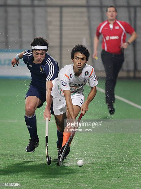 Indian players Kothajit Singh making move as French player vies for the ball during a men's field match between India and France of the FIH London...