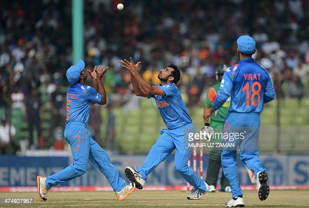 Indian players Mohammed Shami and Ambati Rayudu try to take a catch to dismiss Bangladeshi batsman Shamsur Rahman during the second match of the Asia...
