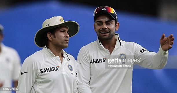 Indian players Sachin Tendulkar and Virat kohli during the third day of the first test match between India and New Zealand at Rajiv Gandhi...