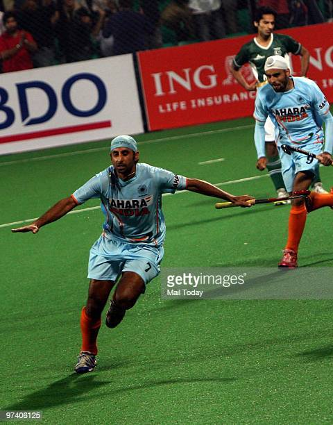 Indian players Sandeep Singh and Prabjot Singh celebrate the victory against Pakistan at the Hockey World Cup in New Delhi on February 28 2010
