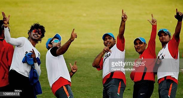 Indian players Shantakumaran Sreesanth Virat Kohli captain MS Dhoni Virender Sehwag and Suresh Raina celebrate after winning a friendly warm up...