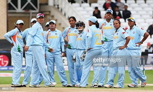 Indian players watch the big screen replay during the ICC Women's World Twenty20 Semi Final between India and New Zealand at Trent Bridge on June 18...