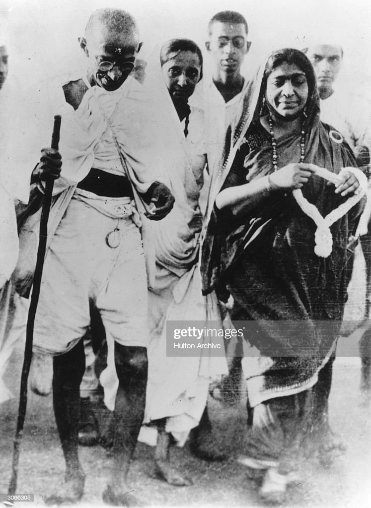 Indian poet and politician Sarojini Naidu with Indian nationalist leader Mahatma Gandhi during the Salt March protesting against the government...