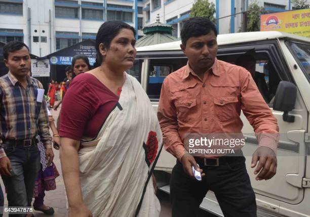Indian police and CID officials escort Chandana Chakraborty from a police station in Siliguri on February 22 for a medical check up to Siliguri...