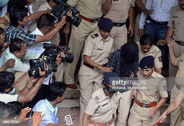 Indian police are surrounded by media as they escort former media executive Indrani Mukherjea from a city court in Mumbai on August 31 2015 A former...