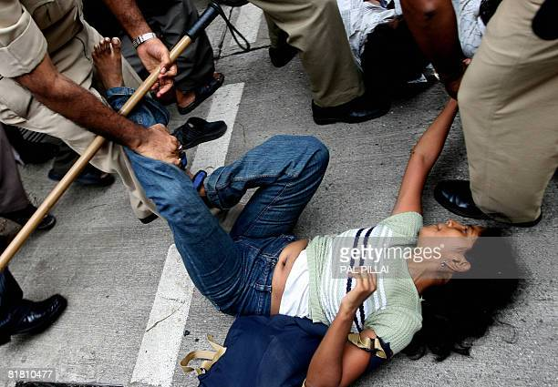Indian police arrest an undergraduate student protesting against the admission policies and job reservation in front of the State Secretariat in...