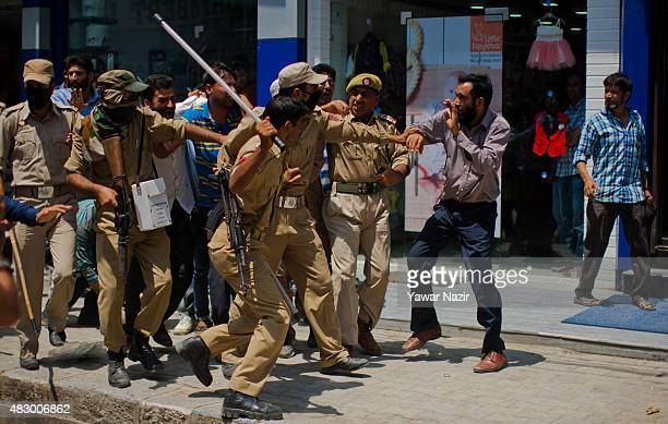 Indian police baton charge Kashmiri government teachers as they shout antigovernment slogans during a protest against government's decision to hold a...