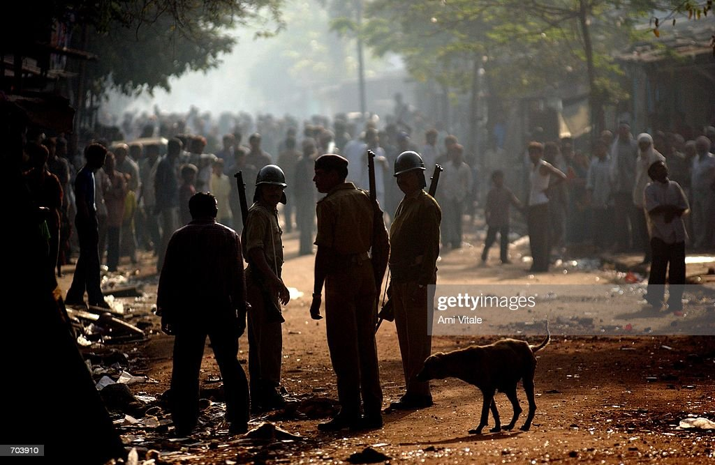 Indian police block a mob of Hindus from attacking Muslims March 1 2002 in Ahmadabad India Indian troops arrived in the riottorn western state of...