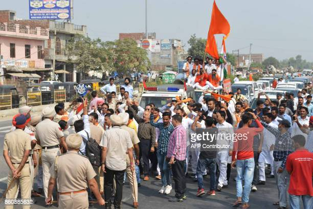 Indian police block activists of Shiv Sena as they march towards the IndiaPakistan Wagah border during a protest march against the killing of Indian...