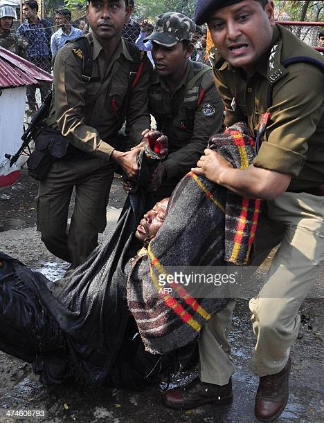 Indian police carry Pranab Boro an activist of Krisak Mukti Sangram Samiti who selfimmolated in a protest demanding land rights for local people in...