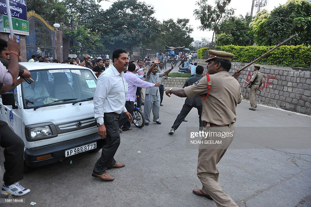 Indian police charge supporters of the Majlis-e-Ittehadul Muslimeen (MIM) party after the arrest of their leader Akbaruddin Owaisi in Hyderabad on January 8, 2013. Owaisi, who is facing multiple cases for his alleged 'hate speech', was arrested by the police. AFP PHOTO/Noah SEELAM