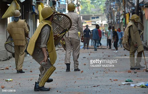 Indian police clash with Kashmiri protestors in Srinagar on July 11 2016 Police said 30 people had now died in three days of clashes between Indian...