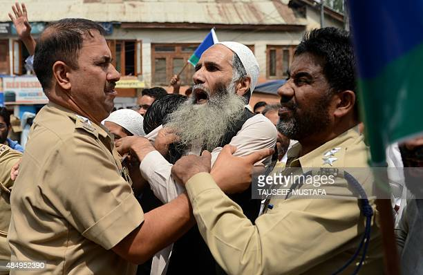Indian police clash with supporters of the hardline faction of the All Parties Hurriyat Confrence during a protest following the house arrest of APHC...