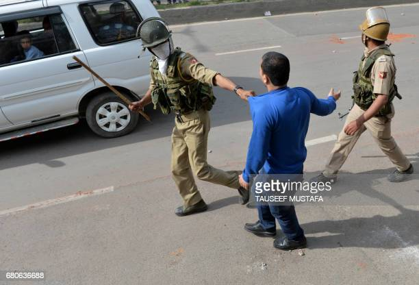 Indian police detain a Kashmiri youth during clashes between Kashmiri students and Indian government forces in central Srinagar's Lal Chowk on May 9...