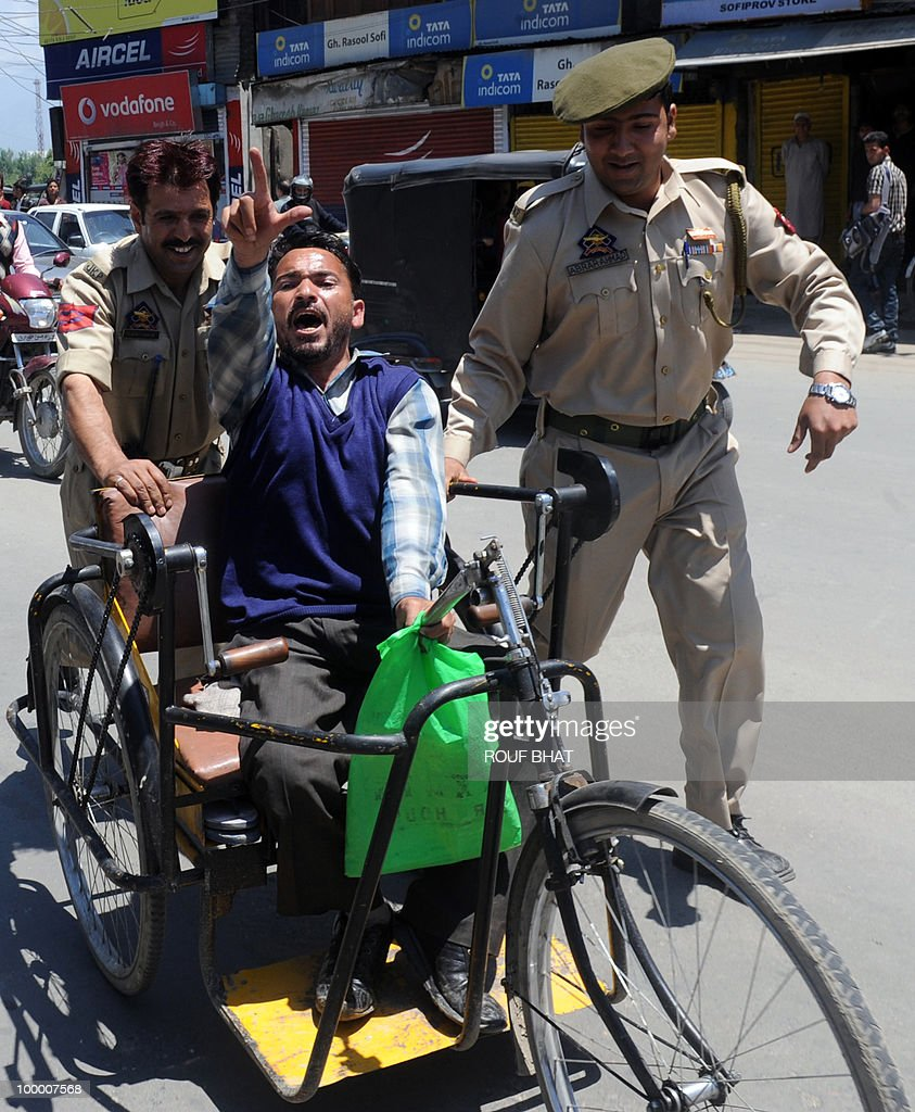 Indian police detain a member of the All Jammu and Kashmir Handicapped Association (AJKHA) as they march towards the civil secretariat which houses the office of chief minister Omar Abdullah, in Srinagar on May 20,2010. The All Jammu and Kashmir Handicapped Association (AJKHA) were demanding an increase in monthly pensions and free education for deaf and blind handicapped people . AFP PHOTO/Rouf BHAT